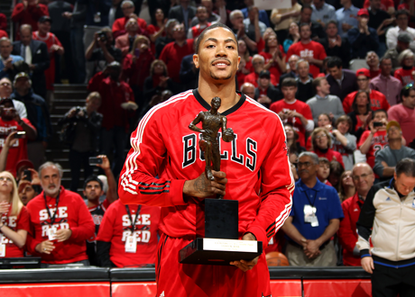 Derrick Rose with his 2011 NBA MVP Award